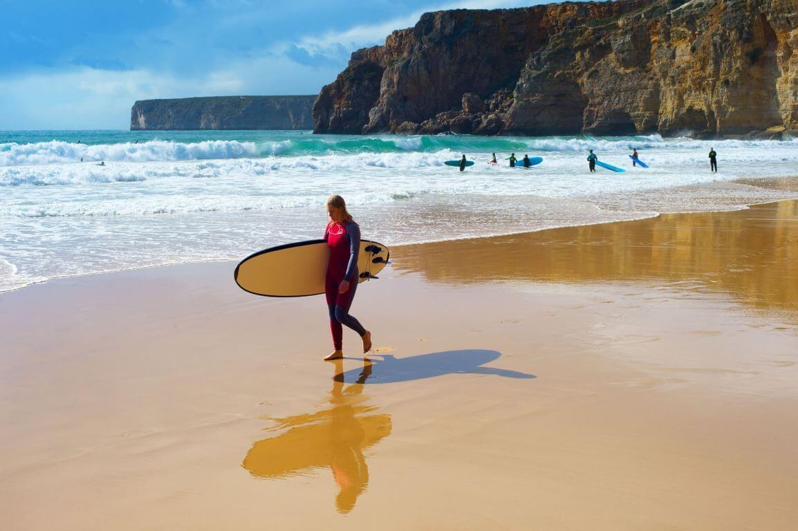 Surfing at Praia do Beliche