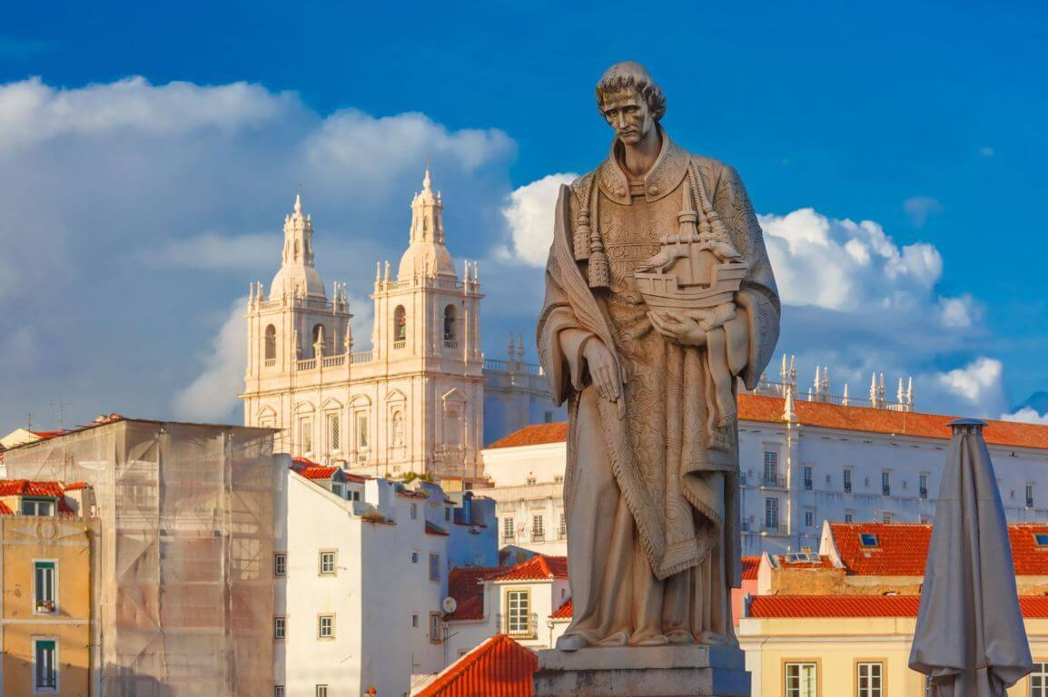 Statue of St. Vincent in Lisbon, with the Monastery of São Vicente in the background