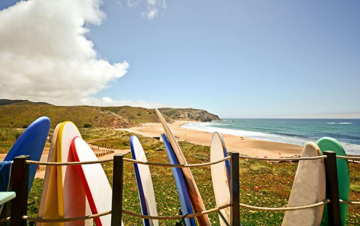 Surfboards with Praia do Amado in the background