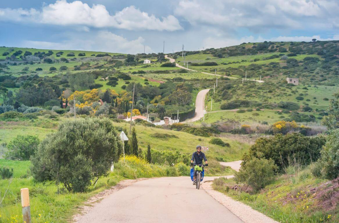Man cycling in the hills in the Algarve in March
