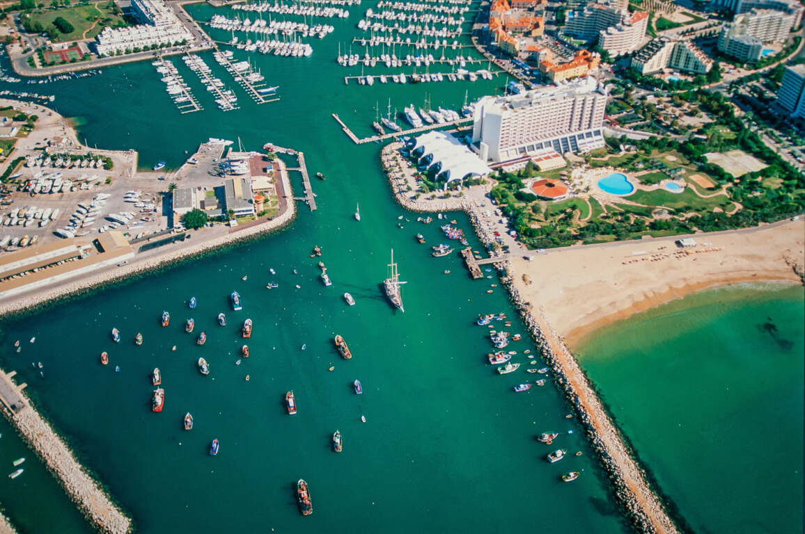 Praia de Vilamoura and the entrance to the marina from above