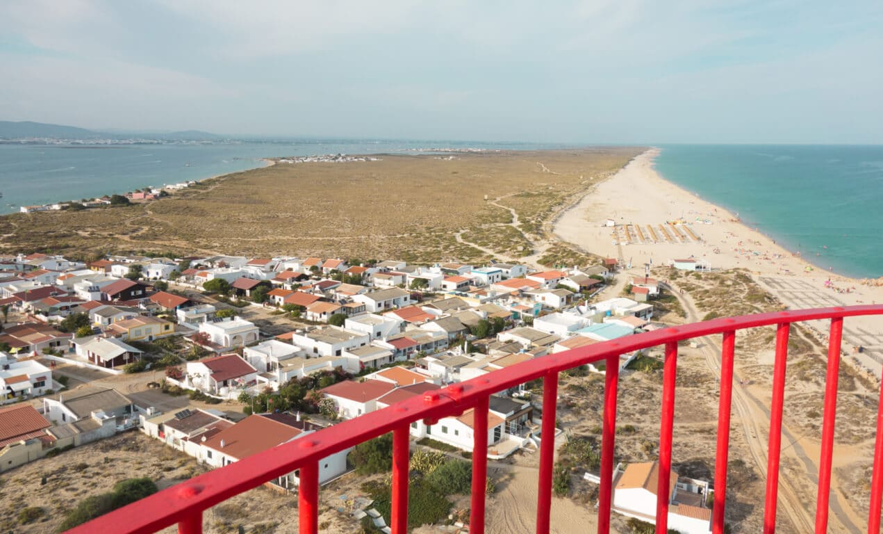 View from the lighthouse of Farol over the island and beach