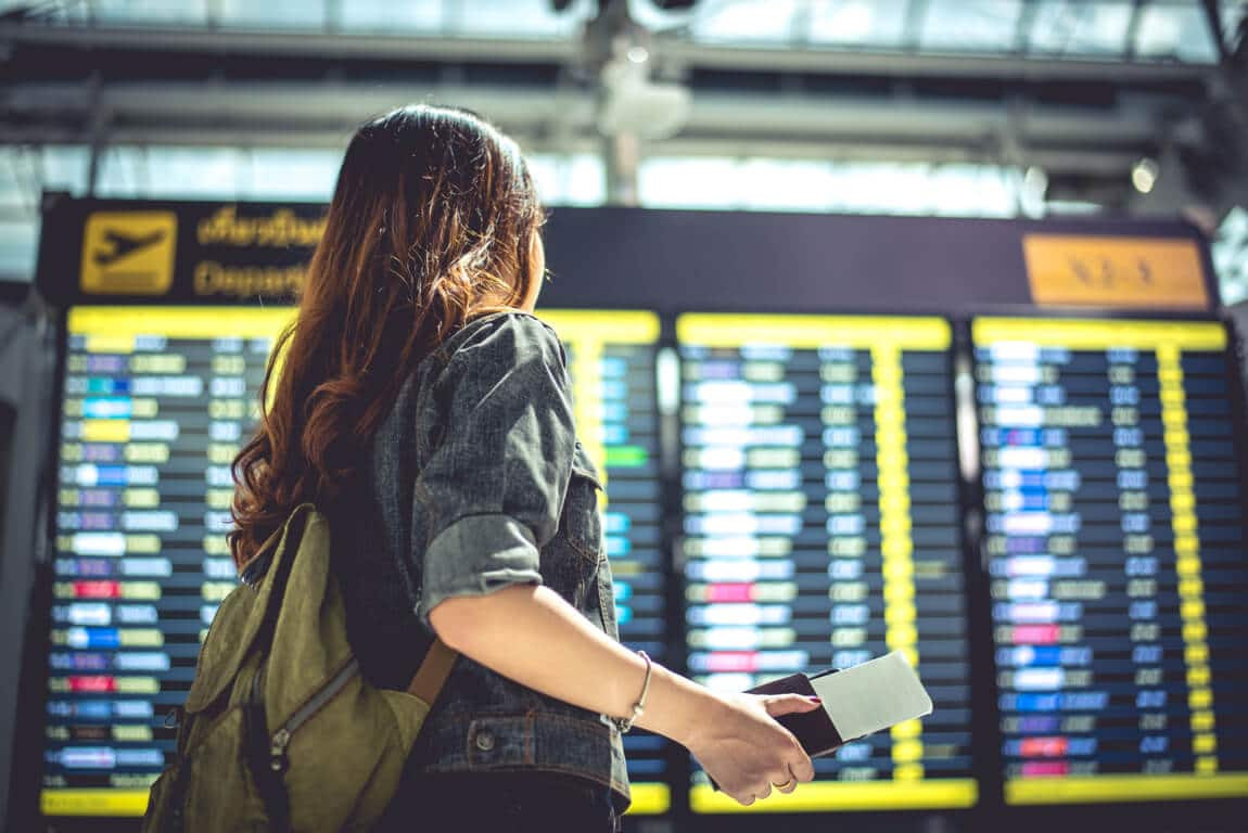 Woman checking flights at airport
