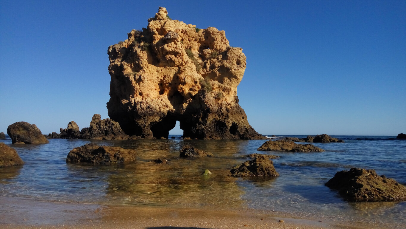 Arch rock formation at Praia dos Arrifes